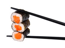Sushi roll in chopsticks Isolated. On white Royalty Free Stock Photos