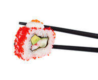 Sushi roll in chopsticks Isolated. On white Stock Images