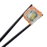 Sushi roll in chopsticks isolated on white Stock Photos