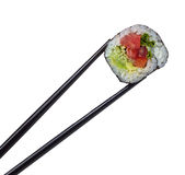 Sushi roll in chopsticks isolated on white Stock Photo