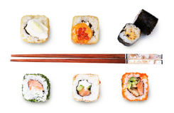 Sushi roll with chopsticks Stock Photos