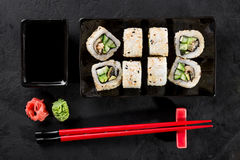 Sushi roll with chopsticks and soy. On a dark background Royalty Free Stock Image
