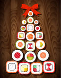 Sushi roll Christmas tree with red bow on wooden table background. Food for Christmas and New Year party Royalty Free Stock Image