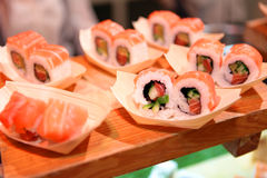 Sushi roll closeup on wooden board Royalty Free Stock Image