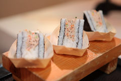 Sushi roll closeup on wooden board Royalty Free Stock Photography
