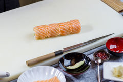 Sushi roll on cooking board. Royalty Free Stock Photography