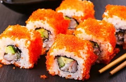 Sushi roll with crab, avocado, cucumber and tobiko. Stock Images