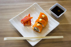 Sushi roll and crab with chopsticks Royalty Free Stock Images
