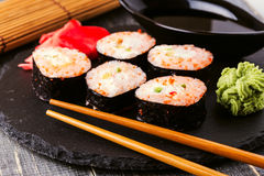 Sushi roll with crab, spicy sauce, cucumber and tobiko caviar. Royalty Free Stock Images