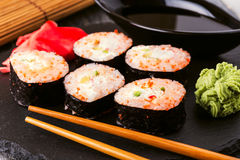 Sushi roll with crab, spicy sauce, cucumber and tobiko caviar. Stock Image