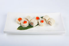 Sushi roll with cream cheese, salmon, scrambled eggs, red caviar stock photo