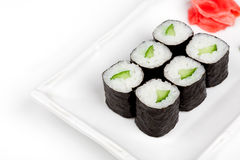 Sushi roll with cucumber and cheese. Close-up of Sushi roll with cucumber and cheese Royalty Free Stock Image