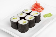 Sushi roll with cucumber and cheese. Sushi roll with cucumber and cheese on the plate Royalty Free Stock Photography