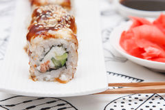 Sushi Roll with Cucumber, Cream Cheese, Salmon and Smoked Eel inside Royalty Free Stock Photo