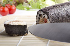 Sushi roll before it is cut into portions Royalty Free Stock Image