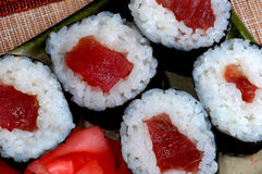 Sushi roll cut. Tuna sushi roll with rice and seaweed Royalty Free Stock Images