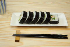 Sushi roll on a dish Royalty Free Stock Images