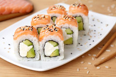 Sushi roll with feta cheese, avocado, cucumber Royalty Free Stock Photo