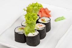 Sushi roll with fish, shrimps and green salad. Stock Photo