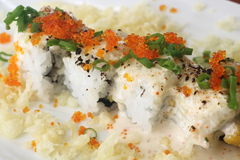 Sushi Roll 3. Japanese sushi roll decorated with fish roes Royalty Free Stock Photography