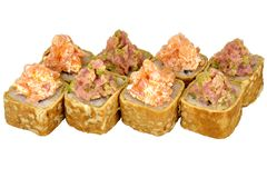 Sushi roll japanese food isolated on white background California sushi roll in omelet with tuna and salmon close-up. Japanese restaurant menu omelette caviar stock images