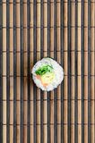 Sushi roll lie on a bamboo straw serwing mat. Traditional Asian food. Top view. Flat lay minimalism shot with copy space.  royalty free stock image