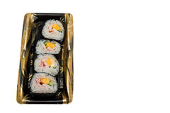 Sushi roll lined in the tray. Sushi roll lined in the tray isolated on white background Royalty Free Stock Image