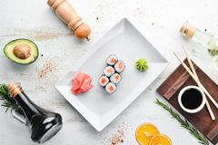 Sushi roll maki with salmon. Japanese cuisine. d. Sushi roll maki with salmon. Japanese cuisine. Top view. On a white wooden background royalty free stock photos