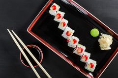 Sushi Roll - Maki Sushi with sea kale, Crab meat, avocado, cream cheese on dark wooden background. Top view. Japanese cuisine stock photography
