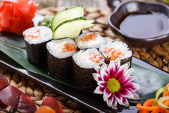 Sushi Roll - Maki Sushi made of Salmon, cream cheese, avocado and wasabi Royalty Free Stock Photo