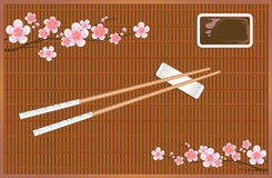 Sushi roll mat. Devices for Asian cuisine. Sakura blossom branches. Vector Stock Photo