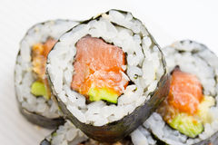 Sushi roll in nori with ginger and wasabi on white plate Royalty Free Stock Photography