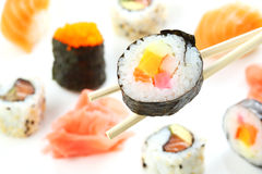 Sushi roll over sticks Stock Images