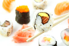 Sushi roll over sticks Royalty Free Stock Photo