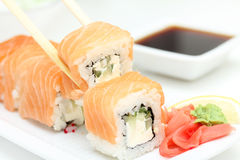 Sushi roll Philadelphia in chopsticks Stock Photo