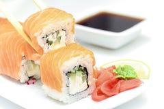 Sushi roll Philadelphia in chopsticks Stock Image