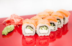 Sushi roll Philadelphia closeup on a red plate Stock Photography