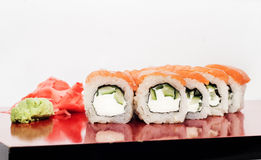 Sushi roll Philadelphia closeup on a red plate Royalty Free Stock Photos