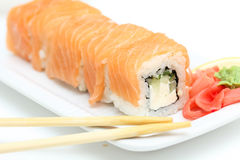 Sushi roll philadelphia on white plate Royalty Free Stock Image