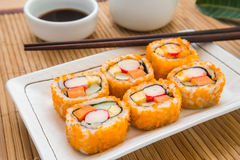 Sushi roll on plate Stock Images