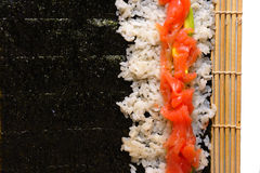 Sushi roll preparation Stock Photography