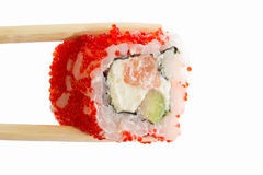 Sushi roll with red caviar isolated on white background Royalty Free Stock Photography