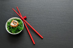 Sushi roll on salad Stock Photography