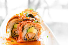 Sushi roll with salmon avocado Stock Photos