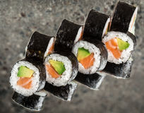 Sushi roll with salmon and avocado Royalty Free Stock Images