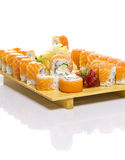 Sushi roll with salmon on a bamboo plate isolated Royalty Free Stock Photos