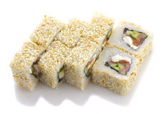Sushi roll with salmon cheese and vegetables rolled in sesame isolated Royalty Free Stock Image