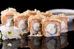 Sushi Roll with salmon and crab meat over  black background with Royalty Free Stock Photos