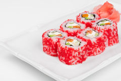 Sushi roll with salmon, crab, shrimps and caviar. Royalty Free Stock Photo