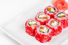 Sushi roll with salmon, crab, shrimps and caviar. Royalty Free Stock Photos